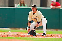 Wake Forest Demon Deacons first baseman Carlos Lopez #3 fields a low throw against the North Carolina State Wolfpack at Doak Field at Dail Park on March 17, 2012 in Raleigh, North Carolina.  The Wolfpack defeated the Demon Deacons 6-2.  (Brian Westerholt/Four Seam Images)