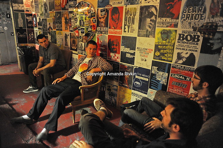 Members of the band Pet Peeve (clockwise L-R) Elliot Esparza, Ryan Flanagan, Mark Adkison, and Lorian Toth are seen in the green room before a live set at the Double Door in Chicago, Illinois on June 5, 2011.