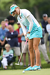 Lexi Thompson watches her putt go in on the 12th green atat the LPGA Championship 2014 Sponsored By Wegmans at Monroe Golf Club in Pittsford, New York on August 13, 2014
