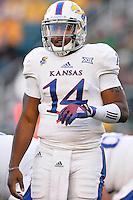 Kansas quarterback Michael Cummings (14) looks at the sideline for a play call during NCAA football game, Saturday, November 01, 2014 in Waco, Tex. Baylor defeated Kansas 60-14. (Mo Khursheed/TFV Media via AP Images)