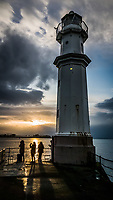 Pictured: Sunset as seen from Newhaven Lighthouse near Edinburgh.<br /> Re: Edinburgh, Scotland, UK. 06 April 2018