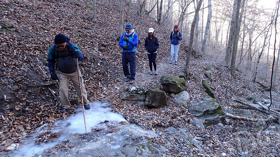 NWA Democrat-Gazette/FLIP PUTTHOFF<br />Gene Williams takes care stepping over an icy patch Jan. 19 2018 on the Buffalo River Trail. Tom Mowry (from left), Thao Nguyen and Karen Mowry wait their turns.