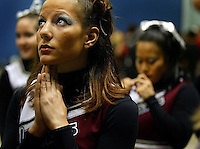 Lauren DeLuca, 20, a sophomore at the University of Massechusetts, says a quick prayer just moments before their perfomance at the National Cheerleading Championships  Thursday April 3, 2003 at the Ocean Center in Daytona Beach. More than 3,700 cheerleaders participated in the preliminary competition, with the finals slated for today at the bandshell in Daytona Beach.(Kelly Jordan)..**FOR DONNA STORY**