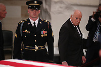 Former Vice President Dick Cheney walks past the casket of former President George H.W. Bush as it lies in state in the U.S. Capitol Rotunda in Washington, U.S., December 3, 2018. <br /> CAP/MPI/RS<br /> &copy;RS/MPI/Capital Pictures
