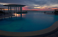 The sun sets over the pool at the Conrad Resort and Casino, overlooking the Rio de la Plata in Punta del Este, Uruguay. The venerable South American beach resort is having a rennaisance. (Kevin Moloney for the New York Times)