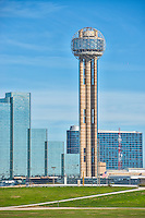 Reuion Tower in downtown Dallas with the Hyatt Regency and the Omin Hotel in the skyline.