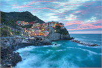 Get up early and you can enjoy some amazing sights along the Ligurian Coast of the Cinque Terre. This image comes from Manarola in the early morning as the sun's light just starts to spread across the vinyards and Villa del Amore.