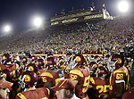 Los Angeles, CA 11/25/06 - The USC Trojans emerge from the tunnel for their game against Notre Dame in a sold out Los Angeles Colisseum<br />