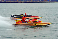 """E-207 """"Happy Budda"""", 280 class hydroplane & E-76 """"Country Stoves"""", 1978 Ed Karelson 280 class cabover hydroplane..10-12 July, 2009, 100th Gold Cup, Detroit River, Detroit, MI USA..©2009 F.Peirce Williams, USA."""