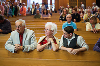 "People gather for the final service at St. Frances Xavier Cabrini Church in Scituate, Mass., on Sun., May 29, 2016. Members of the congregation have been holding a vigil for more than 11 years after the Archdiocese of Boston ordered the parish closed in 2004. For 4234 days, at least one member of Friends of St. Frances X. Cabrini has been at the church at all times, preventing the closure of the church. May 29, 2016, was the last service held at the church after members finally agreed to leave the building after the US Supreme Court decided not to hear their appeal to earlier an Massachusetts court ruling stating that they must leave. The last service was called a ""transitional mass"" and was the first sanctioned mass performed at the church since the vigil began."
