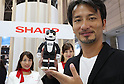"October 4, 2016, Chiba, Japan - Japanese robot creator Tomotaka Takahashi holds humanoid robot smartpone ""RoBoHoN"" which started to sell from Sharp this May at the CEATEC Japan 2016 in Chiba, suburban Tokyo on Tuesday, October 4, 2016. Asia's largest electronics trade show CEATEC started here through October 7.   (Photo by Yoshio Tsunoda/AFLO) LWX -ytd-"