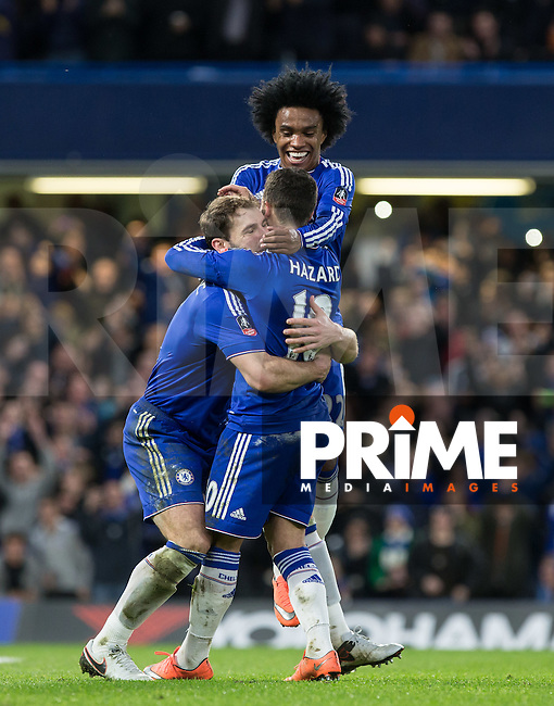 Branislav Ivanovic (left) of Chelsea & Willian of Chelsea celebrate with goal scorer Eden Hazard of Chelsea during the FA Cup 5th round match between Chelsea and Manchester City at Stamford Bridge, London, England on 21 February 2016. Photo by Andy Rowland.