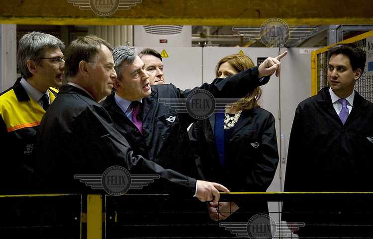 Prime Minister and Labour Party leader Gordon Brown, supported by his wife Sarah, First Secretary of State Lord Peter Mandelson and Energy Secretary Ed Miliband, at an election campaign stop at the BMW Mini car plant in Oxford.
