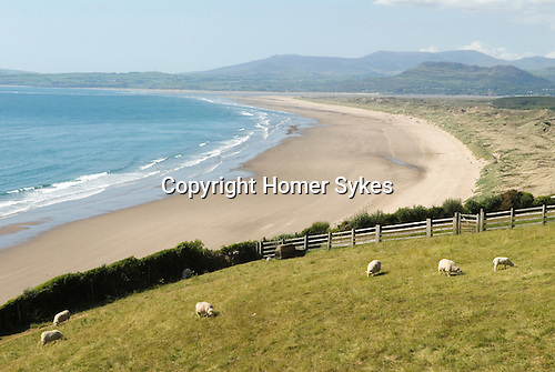 Harlech beach, River Dwyryd estuary in distance and Snowdponia National park. Gwynedd North Wales.