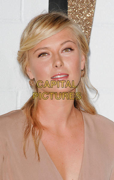 MARIA SHARAPOVA .at The Chloe Los Angeles Boutique Opening Celebration held at Milk Studios in Hollywood, California, USA, April 23rd 2009                                                                     .portrait headshot gold earrings brown.CAP/ROT.©Lee Roth/Roth Stock/Capital Pictures.
