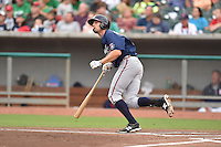 Mississippi Braves third baseman Kyle Kubitza #39 swings at a pitch during a game against the Tennessee Smokies at Smokies Park on July 21, 2014 in Kodak, Tennessee. The Braves defeated the Smokies 4-3. (Tony Farlow/Four Seam Images)