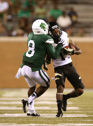 DENTON, TX - AUGUST 31: North Texas Mean Green defensive back Marcus Trice (8) of the North Texas Mean Green Football vs Idaho Vandals at Apogee Stadium in Denton on August 31, 2013 in Denton, Texas. Photo by Rick Yeatts