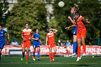 Seattle, Washington - Sunday, June 12, 2016: Seattle Reign FC midfielder Beverly Yanez (17) goes up for a header during a regular season National Women's Soccer League (NWSL) match at Memorial Stadium. Seattle won 1-0.