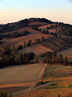 View of countryside north of the Umbrian hilltown of Montone Italy in evening ligh