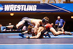 CLEVELAND, OH - MARCH 10: Ben Brisman, of Ithaca, top, wrestles Brett Kaliner, of Stevens, in the 141 weight class during the Division III Men's Wrestling Championship held at the Cleveland Public Auditorium on March 10, 2018 in Cleveland, Ohio. (Photo by Jay LaPrete/NCAA Photos via Getty Images)
