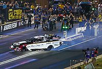 Jul 23, 2016; Morrison, CO, USA; NHRA funny car driver Tim Wilkerson loses control before hitting the wall during qualifying for the Mile High Nationals at Bandimere Speedway. Wilkerson would be uninjured. Mandatory Credit: Mark J. Rebilas-USA TODAY Sports