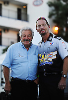 Nov 11, 2010; Pomona, CA, USA; NHRA funny car driver Jack Beckman (right) poses with top fuel dragster driver Chris Karamesines during qualifying for the Auto Club Finals at Auto Club Raceway at Pomona. Mandatory Credit: Mark J. Rebilas-