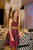 Bat mitzvah girl in an elegant party dress.