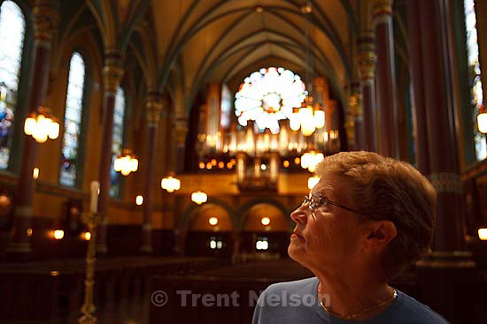 Marty Steiner points out the symbolism of the artwork inside the Cathedral of the Madeleine in Salt Lake City, Utah..Thursday July 30, 2009 in Salt Lake City.