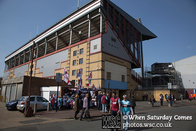 West Ham United 2 Crystal Palace 2, 02/04/2016. Boleyn Ground, Premier League. An exterior view of the Bobby Moore Stand at the Boleyn Ground, pictured before West Ham United hosted Crystal Palace in a Barclays Premier League match. The Boleyn Ground at Upton Park was the club's home ground from 1904 until the end of the 2015-16 season when they moved into the Olympic Stadium, built for the 2012 London games, at nearby Stratford. The match ended in a 2-2 draw, watched by a near-capacity crowd of 34,857. Photo by Colin McPherson.