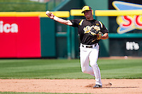Tyler Grimes (12) of the Wichita State Shockers throws to first during a game against the /m/ on April 9, 2011 at Hammons Field in Springfield, Missouri.  Photo By David Welker/Four Seam Images