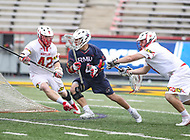College Park, MD - May 13, 2018: Robert Morris Colonials Jimmy Perkins (4) is being defended by two Maryland Terrapins defenders during the NCAA first round game between Robert Morris and Maryland at  Capital One Field at Maryland Stadium in College Park, MD.  (Photo by Elliott Brown/Media Images International)