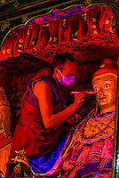 A monk touches up paint on a statue of Padmasambhava, also known as the Second Buddha. Padmasambhava is said to have transmitted Vajrayana Buddhism to Tibet. Samye Monastery, Chatang, Lhoka (Shannan) Prefecture, Tibet (Xizang), China. Samye is the first Buddhist monastery built in Tibet.