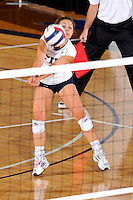 16 October 2010:  FIU libero Angelina Colon (4) returns a shot late in the match as the Western Kentucky Hilltoppers defeated the FIU Golden Panthers, 3-2 (25-19, 23-25, 25-20, 25-27, 15-13), at the U.S Century Bank Arena in Miami, Florida.