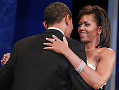 WASHINGTON - JANUARY 20:  (AFP OUT) President Barack Obama dances with his wife Michelle Obama at the Mid-Atlantic Inaugural Ball at the Washington Convention Center on January 20, 2009 in Washington, DC. Obama became the first African-American to be elected to the office of President in the history of the United States.  .Credit: Mark Wilson - Pool via CNP
