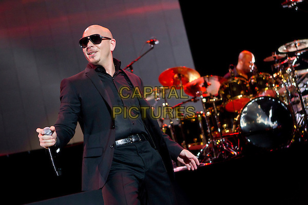 Pitbull (Armando Christian Perez).Concert in Krocus City Hall, Moscow, Russia..May 30th, 2012.on stage live gig performance performing music half length black suit sunglasses shades   .CAP/PER/SB.©SB/PersonaStars/CapitalPictures