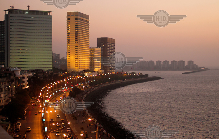 Marine Drive at sunset, looking towards the Oberoi hotel. Mumbai.