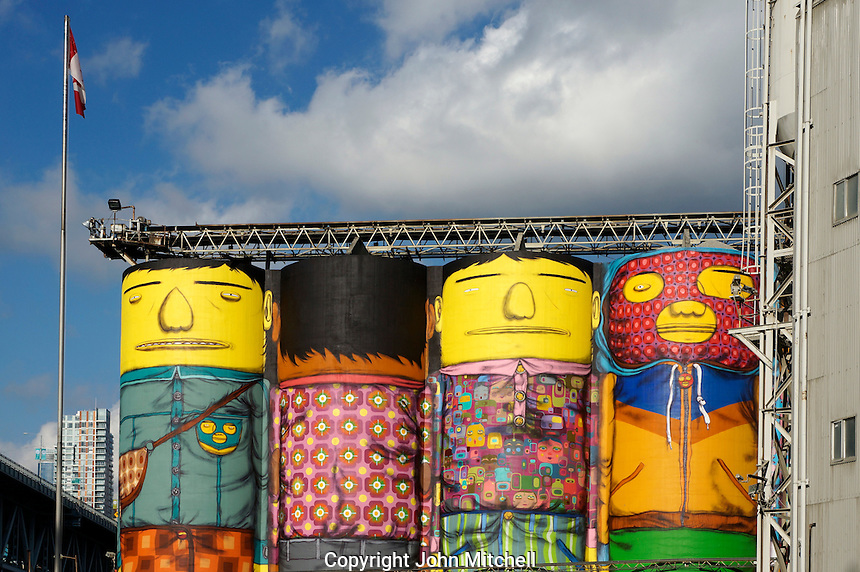 Giants mural painted by OSGEMEOS on silos at Ocean Concrete on Granville Island, Vancouver, BC, Canada The project was part of the Vancouver, Biennale, a non-profit event that promotes public art.
