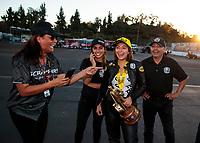 Nov 17, 2019; Pomona, CA, USA; NHRA pro stock motorcycle rider Jianna Salinas celebrates with family after winning the Auto Club Finals at Auto Club Raceway at Pomona. Mandatory Credit: Mark J. Rebilas-USA TODAY Sports