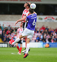 Lincoln City's Matt Rhead vies for possession with Exeter City's Jordan Tillson<br /> <br /> Photographer Andrew Vaughan/CameraSport<br /> <br /> The EFL Sky Bet League Two Play Off First Leg - Lincoln City v Exeter City - Saturday 12th May 2018 - Sincil Bank - Lincoln<br /> <br /> World Copyright &copy; 2018 CameraSport. All rights reserved. 43 Linden Ave. Countesthorpe. Leicester. England. LE8 5PG - Tel: +44 (0) 116 277 4147 - admin@camerasport.com - www.camerasport.com