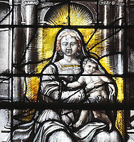 Detail of Notre Dame de Liesse or Our Lady of Liesse, 1634, in the Collegiate Church of Saint-Gervais-Saint-Protais, built 12th to 16th centuries in Gothic and Renaissance styles, in Gisors, Eure, Haute-Normandie, France. This is a grisaille stained glass window with limited colours, originally Renaissance in design but later added to. The church was consecrated in 1119 by Calixtus II but the nave was rebuilt from 1160 after a fire. The church was listed as a historic monument in 1840. Picture by Manuel Cohen