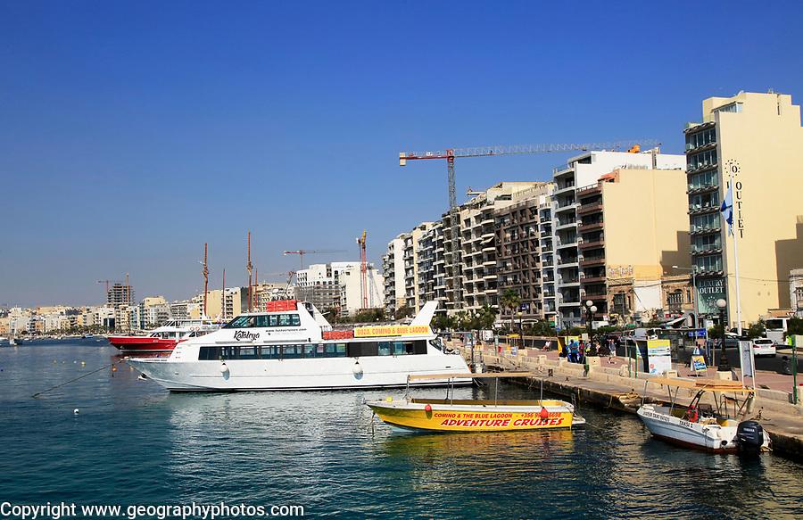 Tour boats on waterfront quay at Sliema, Valletta, Malta