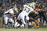 Beverly Hills, CA 09/23/11 - \b54\, Ernesto Gamboa (Peninsula #53) and unidentified Peninsula player(s) in action during the Peninsula-Beverly Hills Varsity football game.