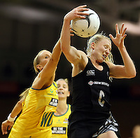 15.09.2013 Silver Ferns Laura Langman and Australian Diamonds Renae Hallinan in action during the Silver Ferns V Australian Diamonds New World Netball Series played at SIT Zero Fees Velodrome in Invercargill. Mandatory Photo Credit ©Michael Bradley.