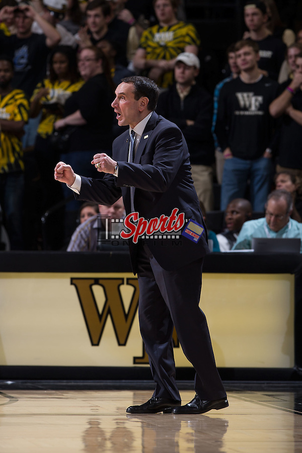 Duke Blue Devils head coach Mike Krzyzewski yells instructions to his team during second half action against the Wake Forest Demon Deacons at the LJVM Coliseum on January 7, 2015 in Winston-Salem, North Carolina.  The Blue Devils defeated the Demon Deacons 73-65.  (Brian Westerholt/Sports On Film)