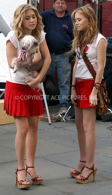 Ashley Olsen and Mary-Kate Olsen filming their latest movie, 'New York Minute.' New York, October 6, 2003. Please byline: NY Photo Press.   ..*PAY-PER-USE*      ....NY Photo Press:  ..phone (646) 267-6913;   ..e-mail: info@nyphotopress.com