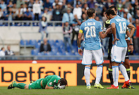 Calcio, Serie A: Lazio vs Frosinone. Roma, stadio Olimpico, 4 ottobre 2015.<br /> Lazio's goalkeeper Federico Marchetti, left, lies on the pitch after getting injured during the Italian Serie A football match between Lazio and Frosinone at Rome's Olympic stadium, 4 October 2015.<br /> UPDATE IMAGES PRESS/Isabella Bonotto