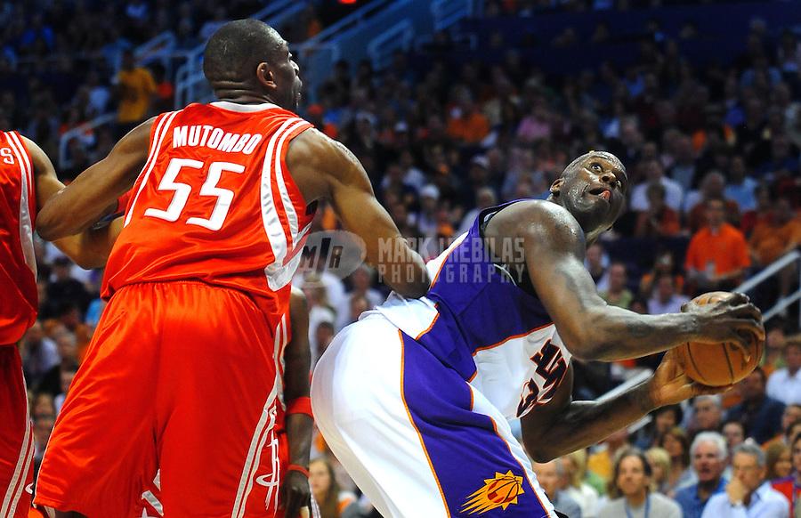 Mar. 22, 2008; Phoenix, AZ, USA; Phoenix Suns center (32) Shaquille O'Neal shoots under pressure from Houston Rockets center (55) Dikembe Mutombo at the US Airways Center. Mandatory Credit: Mark J. Rebilas