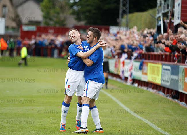 Andy Little (R) celebrates his goal for Rangers with Barrie McKay