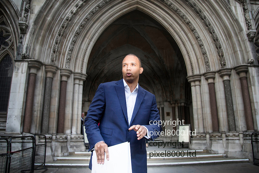 pic shows:<br /> <br /> <br /> World's number one poker star Phil Ivey leaves at the High Court in London today 2.10.14<br /> He arrived with his legal team carrying bundles of papers in his case against Crockfords casino in Mayfair, London which is owned by Gentings.<br /> <br /> The high stakes gambler who is suing Britain&rsquo;s oldest gaming club for withholding his &pound;7.3million payout<br /> They claim he was &quot;edge counting&quot;<br /> <br /> He arrived with two women of Asian appearance who may be part of his legal team or involved in the case.<br /> <br /> <br /> <br /> <br /> <br /> <br /> Pic by Gavin Rodgers/Pixel 8000 Ltd