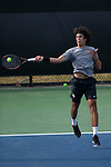 Skander Mansouri of the Wake Forest Demon Deacons returns the ball against the Florida Gators during his match at #3 singles at the Wake Forest Tennis Center on March 30, 2018 in Winston-Salem, North Carolina.  The Gators defeated the Demon Deacons 4-3.  (Brian Westerholt/Sports On Film)